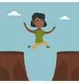 young african sportswoman jumping over the cliff vector image vector image