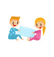 cute kids in pajamas playing with pillow brother vector image vector image