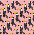 seamless pattern with toucans on a pink vector image