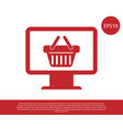 Red computer monitor with shopping basket icon
