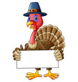 cartoon turkey holding blank sign vector image vector image