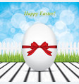 easter eggs on wood texture with grass vector image