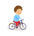 flat boy riding bicycle isolated vector image
