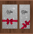 silver glitter background with realistic red bow vector image