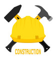 Construction worker s helmet and hammers