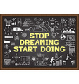 Stop dreaming start doing on chalkboard