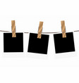 three blank polaroid frames hanging on a rope vector image vector image