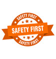 safety first ribbon safety first round orange vector image vector image