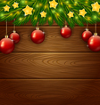 Christmas ornament and wooden background vector image vector image