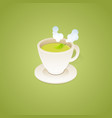 A cup of tea and leaves isolated on green
