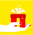 woman hand holding gift yellow vector image vector image