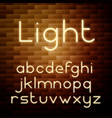 yellow glowing neon alphabet vector image vector image