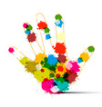 human hand with colorful splashes art creation vector image vector image