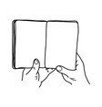 close-up hand holding book with blank pages vector image