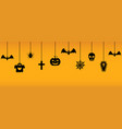 halloween hanging ornaments on orange background vector image vector image