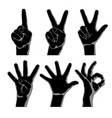black silhouettes hands showing one two vector image