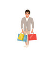 smiling guy standing with shopping bags in hands vector image vector image