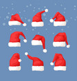 hand drawn christmas hat and snow on blue vector image