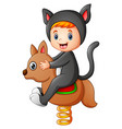 kid in a cat costume playin vector image