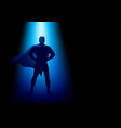 superhero standing under the blue light vector image vector image