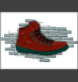 red lace-up shoes on a gray brick wall background vector image vector image