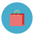 shopping bag icon on round blue background vector image vector image