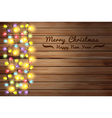 Christmas lights on wooden background vector image