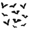 flock of bats black shadows of bats on a white vector image vector image