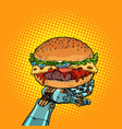 burger on a robot arm vector image vector image