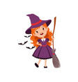joyful red-haired girl witch standing with broom vector image