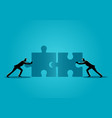 businessmen pushing two jigsaw pieces vector image vector image
