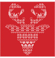 Winter pattern reindeer head frontal on red vector image vector image