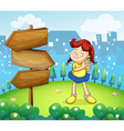 A little girl standing beside the wooden arrow vector image vector image