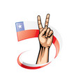 chile flag and hand on white background vector image vector image