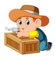 smart cowboy holding his gun and behind the box vector image vector image