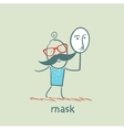 man holding a mask vector image vector image
