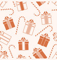 christmas gifts and candy cane seamless pattern vector image vector image