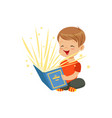 little boy sitting on the floor with magic book vector image vector image