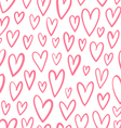 Hand drawn doodled hearts seamless pattern vector image
