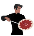 handsome spanish chef holding a knife and showing vector image