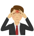 young businessman with headache vector image