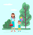 mother kid with balloons on holiday celebration vector image vector image