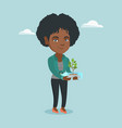 woman holding plant growing in a plastic bottle vector image vector image