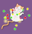 cute cat plays with a multi-colored garland vector image vector image