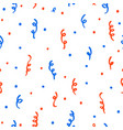 Red and blue confetti on a white background
