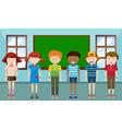 Children standing in classroom vector image