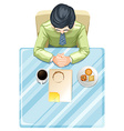A topview of a man at the table vector image vector image