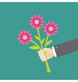 Businessman hand holding bouquet of three pink vector image vector image