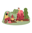man and woman frying marshmallows on fire picnic vector image