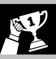 award cup in hand 1st place winner vector image